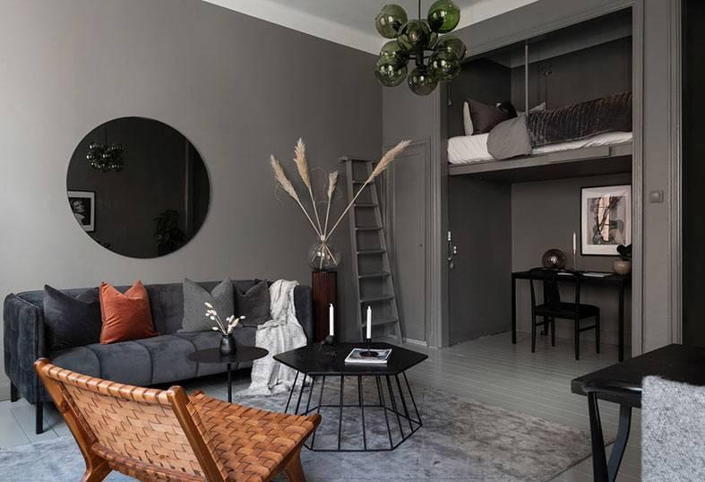 темно-серый цвет стен в квартире, круглое зеркало на стене