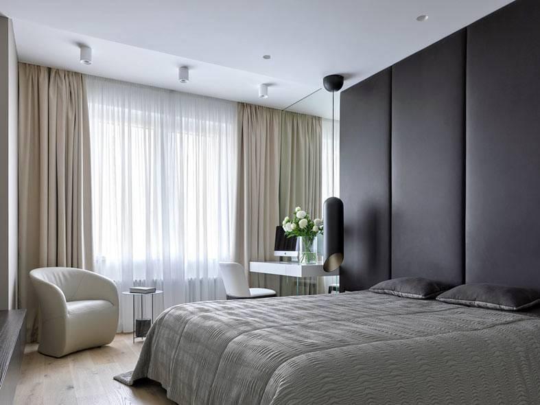 черные мягкие стеновые панели в изголовье кровати