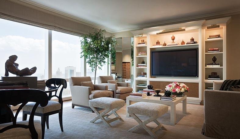 элегантный интерьер гостиной, шкаф с подсветкой и телевизором