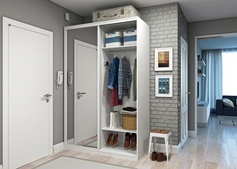белый шкаф-купе возле кирпичной стены в коридоре