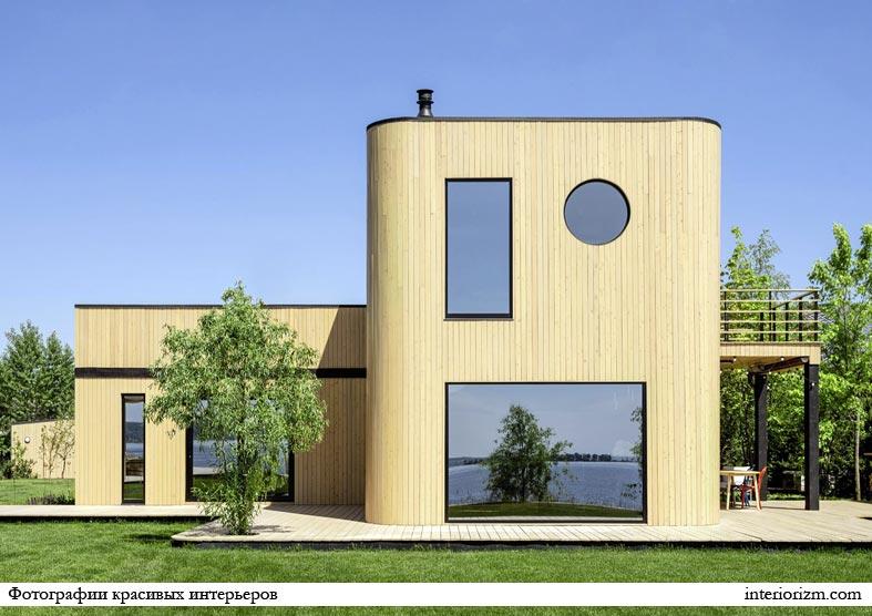 необычная современная архитектура дома из дерева